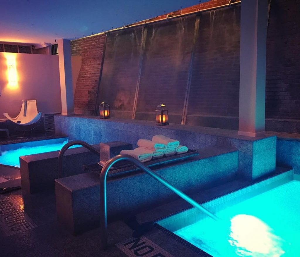 illuminated room with indoor jacuzzis