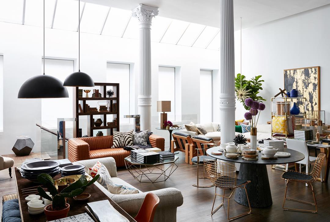 Stylish furniture store with sofas, tables and shelves with large columns
