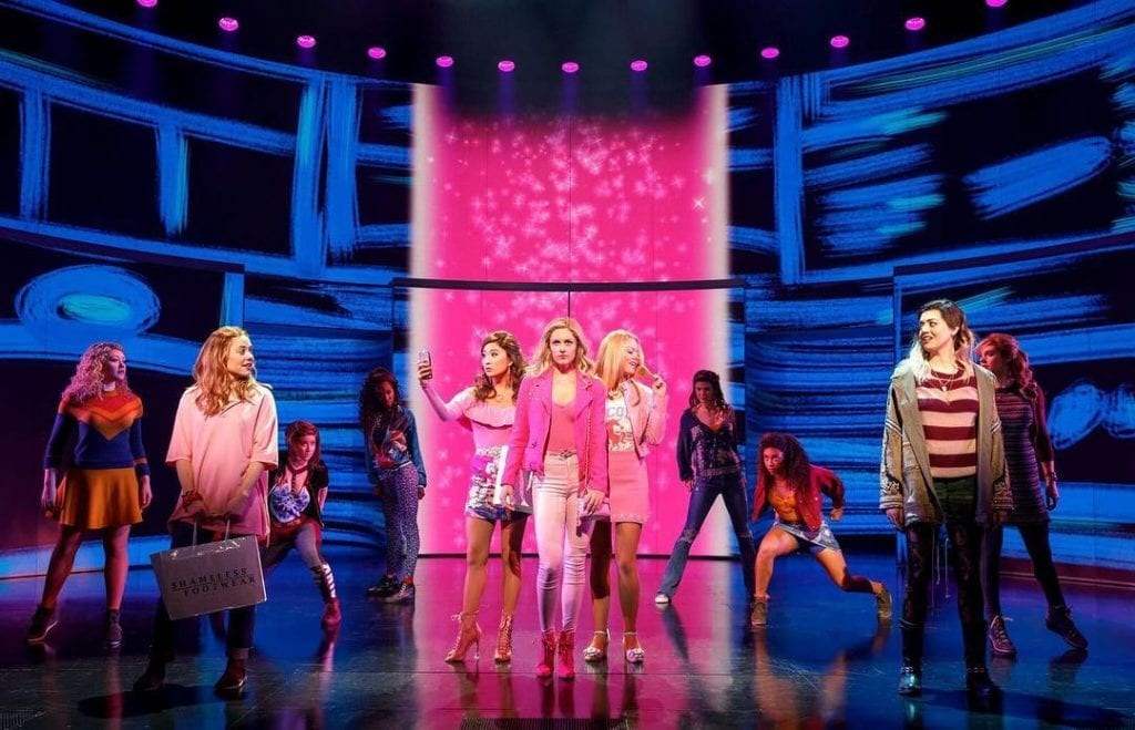 Group of actors on stage at Mean Girls play