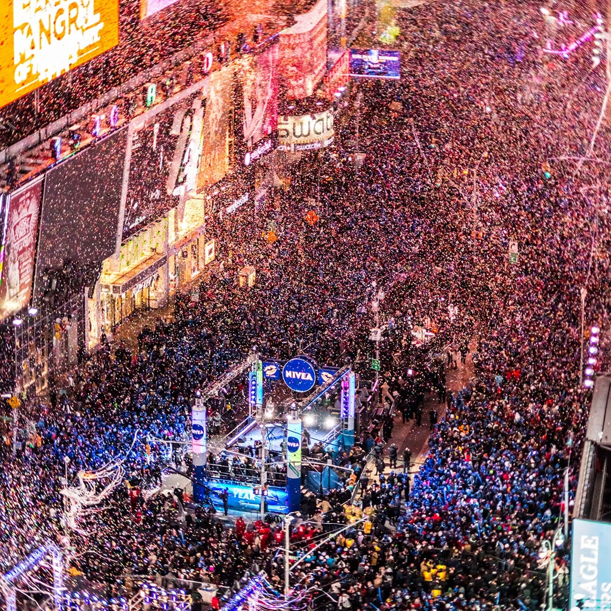 Confetti falling on Times Square and crowd gathered around stage