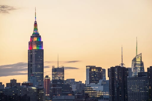 New York skyline with Empire State illuminated in rainbow colors