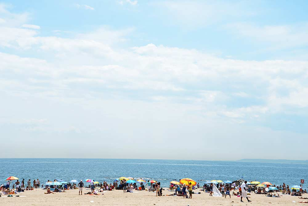 people on a New York beach on a sunny day