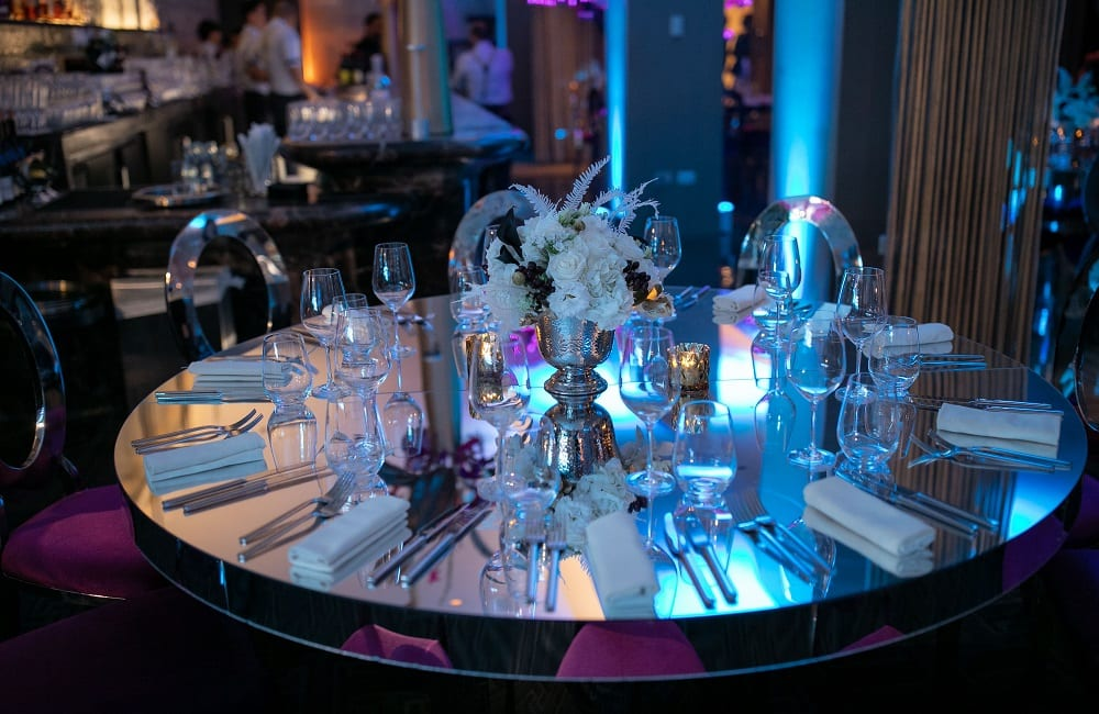 Closeup of stylish glass table with centerpiece