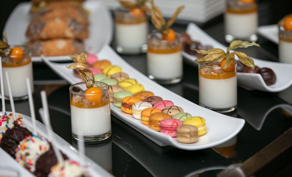 Closeup of table with various desserts on plates